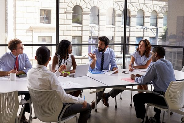 Consultants meeting around a conference table